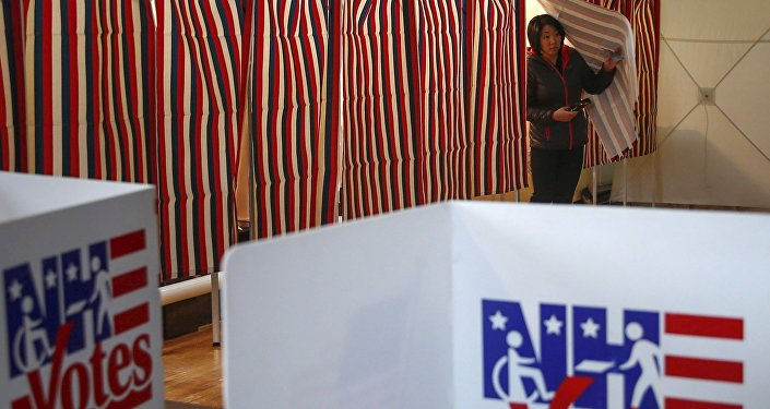 A woman looks to cast her ballot after voting in New Hampshire's first-in-the-nation primary in Bethelehem Town Hall, New Hampshire