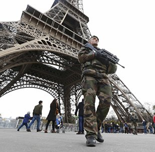 French military patrol near the Eiffel Tower the day after a series of deadly attacks in Paris , November 14, 2015